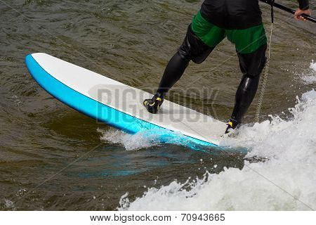 Expert Stand Up Paddleboarder In White Water