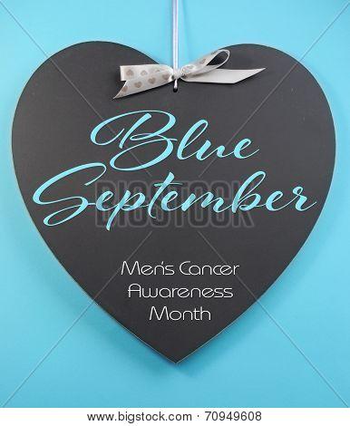 Blue September message on blackboard