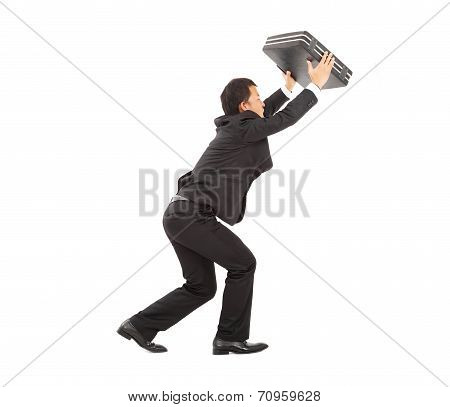 Terrified Businessman Using Briefcase To Protect.