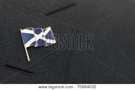 Scotland Flag Lapel Pin On The Collar Of A Business Suit