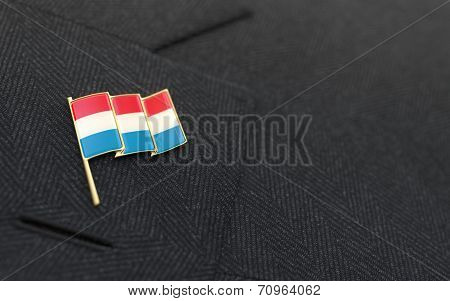 Luxembourg Flag Lapel Pin On The Collar Of A Business Suit