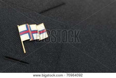 Faroe Islands Flag Lapel Pin On The Collar Of A Business Suit