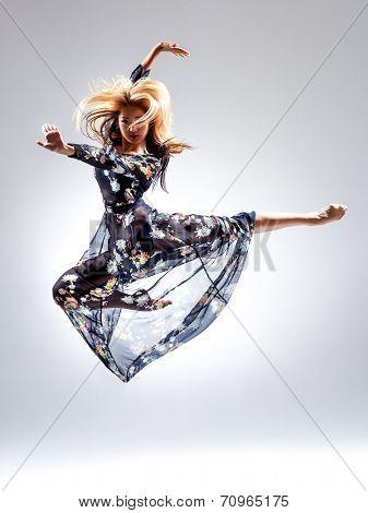 female dancer posing on studio background