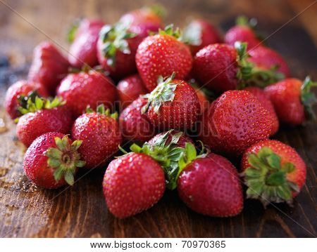 pile of strawberries on wood board