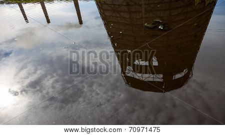 Cooling Tower And Smokestacks Of The Cogeneration Plant Reflected In Water