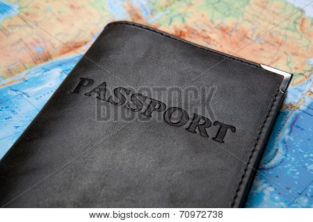 Passport In The Bag On A Map