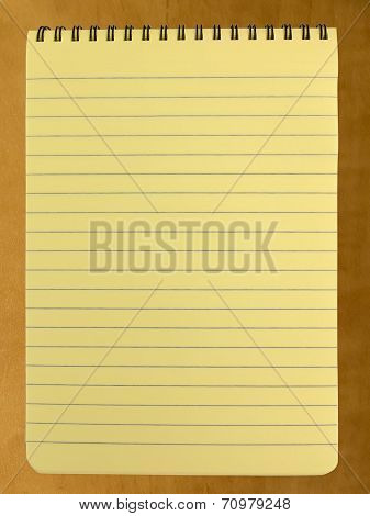 Blank spiral bound yellow legal pad on office desk poster