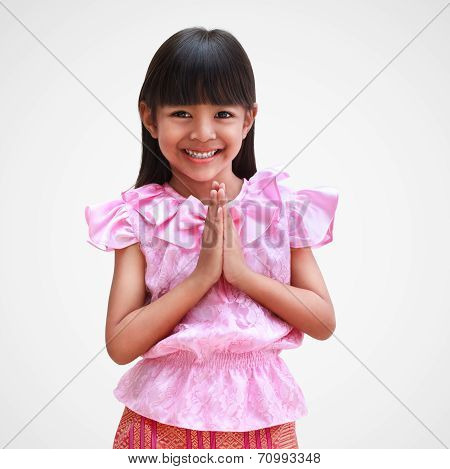 Little thai girl welcome expression sawasdee Isolated on grey background