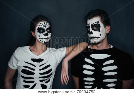 Couple In Costume Of Skeletons