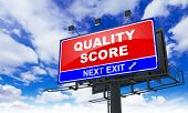 Quality Score - Red Billboard on Sky Background. Business Concept. poster