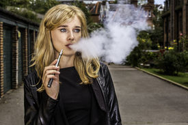 Pretty Woman Smoking An E-cigarette