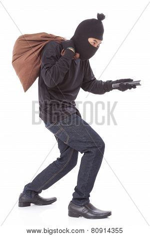 Thief with bag and holding flashlight, isolated on white background poster
