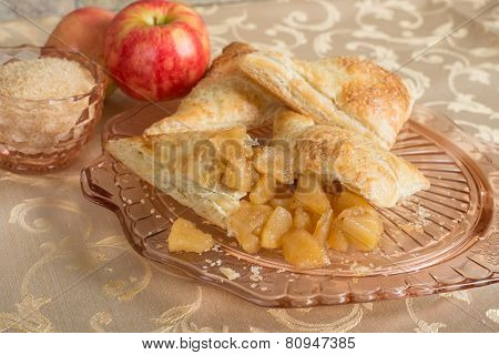 Cut Open Apple Turnover On And Antique Plate