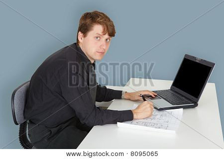 Young Specialist Working On Project In Office