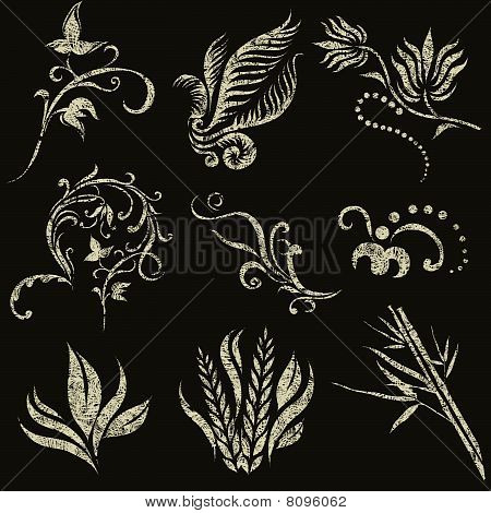 Vector set of grunge leafs and flower design elements