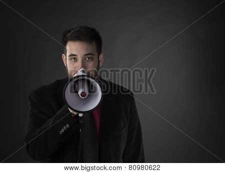 Young Man in Formal Wear Holding Megaphone