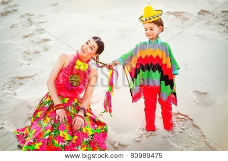happy boy and his mother wearing Mexicans