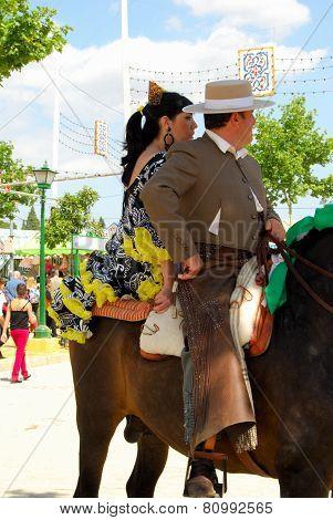 Spanish couple on a horse, Seville.
