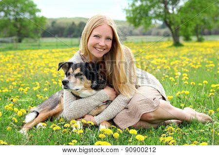 Happy Woman Hugging German Shepherd Dog