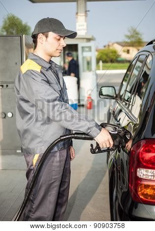 Portrait of a gas station attendant at work