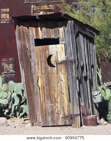 An Old Mining Camp Outhouse In The Desert