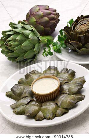 eating boiled artichoke