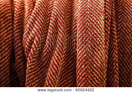Cozy, Draped Red and Tan Herringbone Blanket Close Up