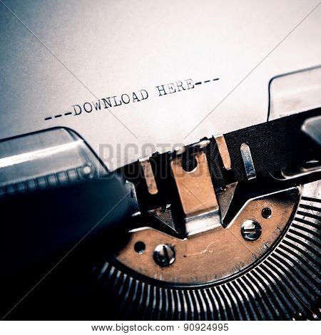 Typewriter closeup shot concept of download, retro