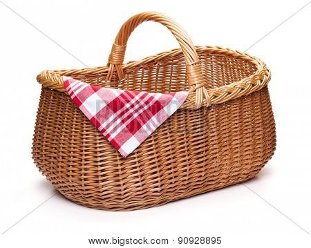 Wicker picnic basket with red checked napkin, isolated on the white background.