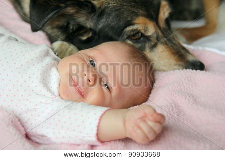 Happy Newborn Baby Snuggling With Pet Dog