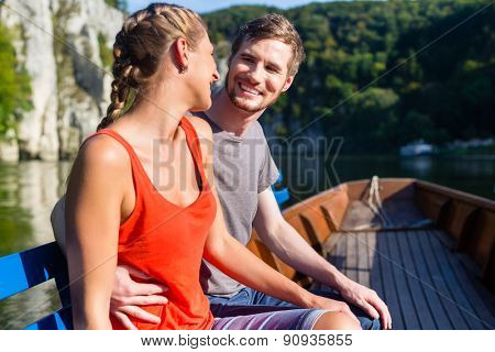 Couple, man and woman, on boat at Danube gorge, tourism concept poster