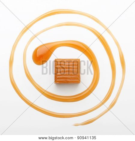 Caramel toffee and sauce isolated on a white background