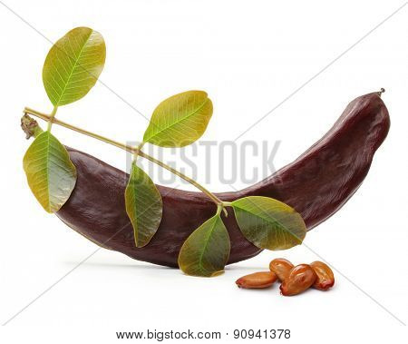 Carob pod and seeds isolated on a white background