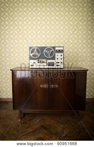 Old portable reel to reel tube tape-recorder, toned, with copyspace. Toned