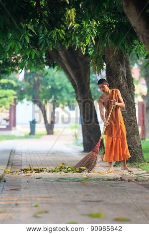 Ayuthaya Thailand : March 28 : Thai Buddhist Monk Daily Cleaning Temple Area In Morning Routine Work