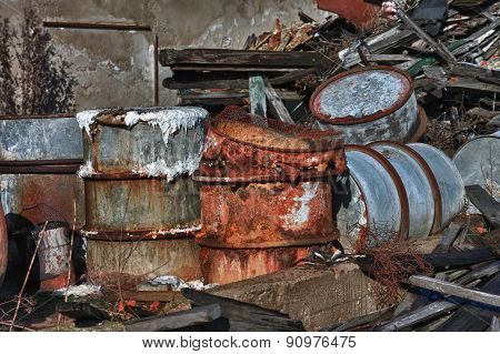 Group of old rusty barrels with toxic chemical waste. Photo was taken on place where textile factory was wrong demolished.HDR photo. poster