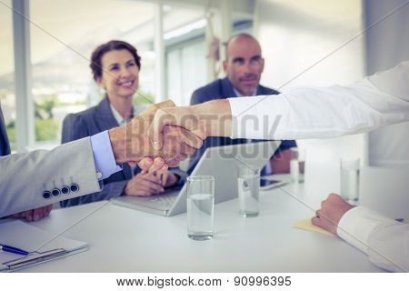 Business people shaking hands at interview in the office