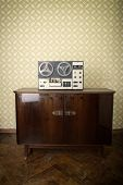 Old portable reel to reel tube tape-recorder, toned, with copyspace. Toned poster