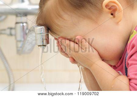 Little Girl Washing Her Face