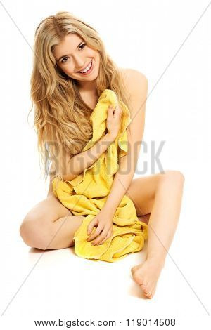 Woman sittting wrapped in towel