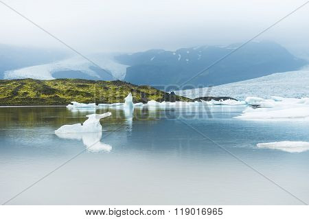 Icebergs In The Glacial Lake With Mountain Views.