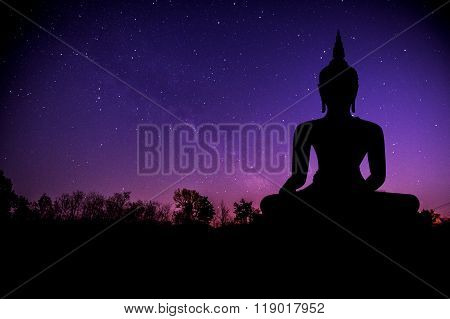 The Milky Way And Silhouette Of Buddha Statue.