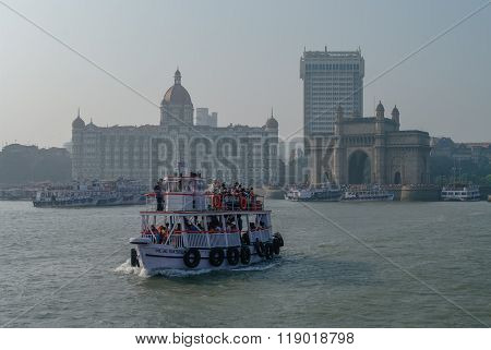 Mumbai, India - January 1, 2012: The Taj Mahal Palace Hotel And Gateway Of India Form Water.