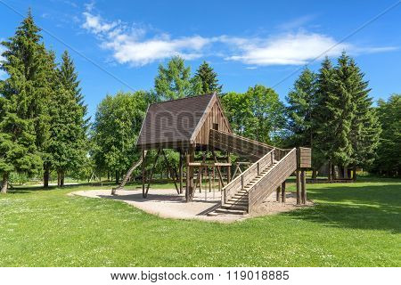 Playground with wooden house