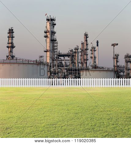 Oil Refinery And Green Lawn.