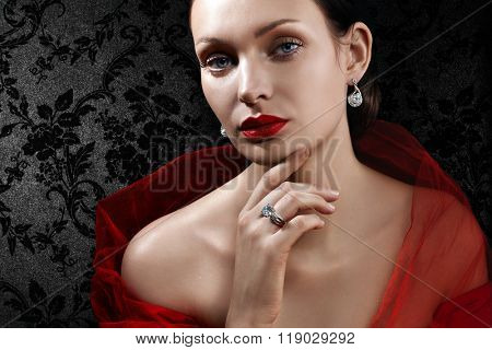 Beautiful woman with jewellery on dark background
