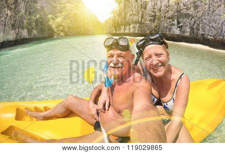 Senior Happy Couple Taking Selfie On Kayak At Big Lagoon In El Nido Palawan - Travel To Philippines