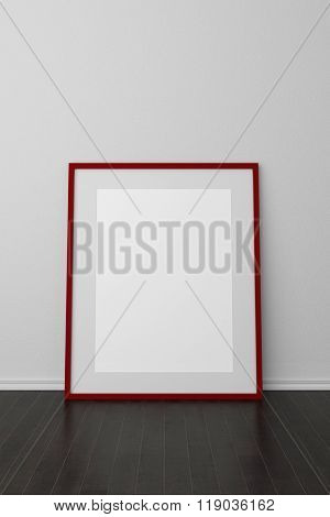 Empty picture frame leaning on wall on a wooden floor (3D Rendering)