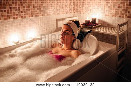 Woman lying in tub doing hydrotherapy treatment