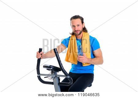 Young Man Train With Fitness Machine And Drinking Water